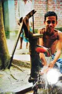 A typical well in rural Bangladesh. The red paint on the spout indicates that the water is contaminated with arsenic.