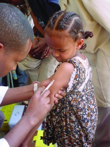 A child in the Millennium Villages receives health care