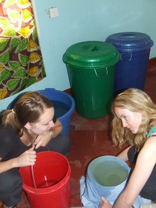 MDP students, Lauren Richards and Sarah Curran, filter well water for cooking and drinking at our house in Tabora