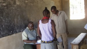 Francis at Ibiri Primary School with Agriculture and Environment Committee members from Ibiri, Msimbo and Inonelwa