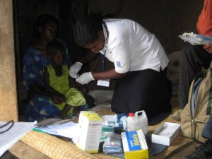 A CHW using a Rapid Diagnostic Test (RDT) to test for Malaria