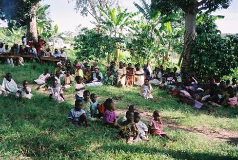 A listening group in Uganda discussing the meaning of a climate forecast. Source: CRED.