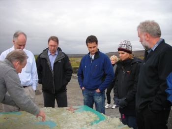Klaus Lackner, Juerg Matter and Martin Stute with other conference participants examine a topographic map of Iceland.