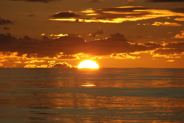 The sun sets over the calm waters above the East Pacific Rise. We saw many such settings of the sun that were just as beautiful as this one. (Photo by Wanda Vargas)