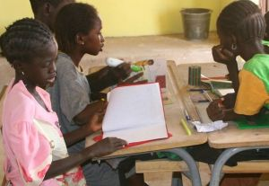 Girls in Louga, Senegal learn how to use a digital reader in a workshop facilitated by MCI partner CyberSmart