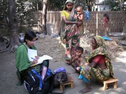 Health worker with villagers in Bangladesh