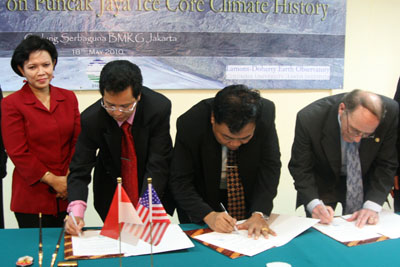Project scientists (starting second from left) Dwi Susanto, Dodo Gunawan and Lonnie Thompson sign documents launching the glacier-coring expedition.