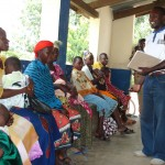 A health facilitator interacts with patients at Illolangulu dispensary. Source: Millennium Promise Blog