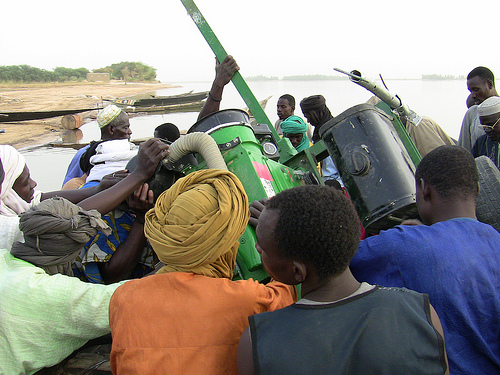 They are then loaded onto a motor boat in the Niger River, and transported to the villages, where residents await their arrival.