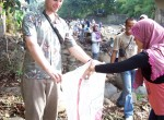 Fellow Columbia graduate student Daniel Huber participates in the Ciliwung river bank cleanup