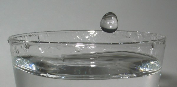 water drop falling into cup