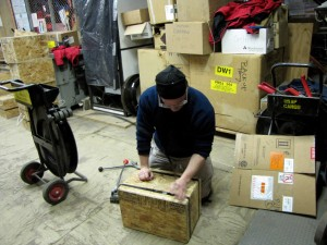 Mike Kaplan putting together a wood 'rock box' to transport collected rocks back to Lamont