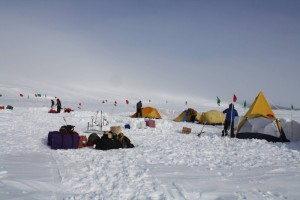 Happy Camper - required survival camping training where one learns to make camp on the ice, including snow trenches and other survival strategies, in case of misadventure while out in the field