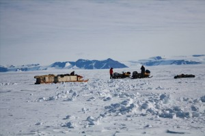 Using snowmobiles to move to the next field camp site at Mt Archernar