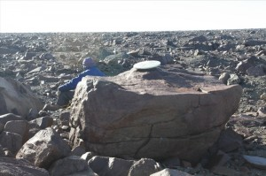 Collecting samples from the top of boulders that got left back by the retreating glaciers. At home in the lab at Lamont, we will use a method called 'Surface Exposure Dating' to figure out when the ice sheet left these boulders behind when it retreated.