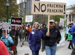 Anti-fracking demonstrators begin the half-mile march to the state's DEC headquarters. Photo by Benjamin Preston