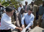 Prof Jeffrey Sachs, Walter Wang,and officials from the government of Rwanda inaugurate a water point in Gakindo; Photo Courtesy of Guillaume Bonn