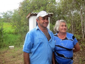 Dona Cardilina and her husband Francisco. The power switch for Ingá's water pump, which Franscisco helps operate, is located in the small shed behind them.