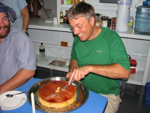 Steve cutting his flan birthday cake