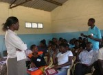 A public health officer trains new Community Health Workers in Manyatta A.