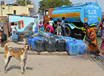 Residents of Kusumpur Pahari, a slum in south New Delhi, fill containers with water from a municipal Delhi Jal Board tanker.