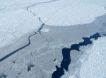 Sea Ice along Greenland's Eastern coast shows areas of thicker (white) and thinner ice (translucent) sliced through with open water leads. (photo M. Turrin)