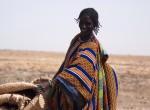 Malian women working on vulnerable barren lands near Timbuktu.