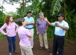 Dr. Glenn Denning, Dr. Gordon McCord, along with Lidia Fromm from the Ministry of Planning and Vice-Minister of Social Development Karla Cueva hear from a local farmer in Choluteca about the pest problems in local agriculture.
