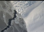 Sea Ice on the left, touching up against an ice shelf along West Antarctica. (Photo from the camera in the belly of the plane). The plane is flying at ~1500 ft. of elevation - the estimated field of view is ~450 meters.