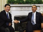 China's President in waiting Xi Jinping shakes hands with US President Barack Obama