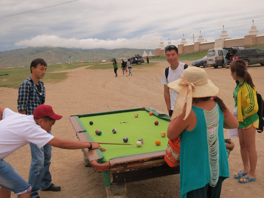 Many daily activities, like this pool game at a roadside stop, routinely take place in the open.