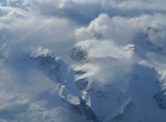 Greenland's west coast is lined with ice-topped mountains reaching up to touch the clouds. (photo M. Turrin)