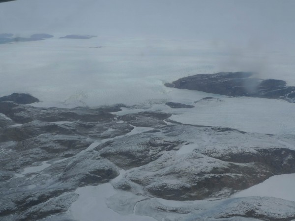 The edge of the ice sheet is just visible flying towards Raven Camp in the south central section of Greenland.