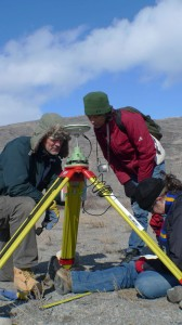 up a GPS at Kangerlussuaq airstrip. L-R Nick Frearson, Margie Turrin, Kirsty Tinto, LDEO (Image R. Bell)