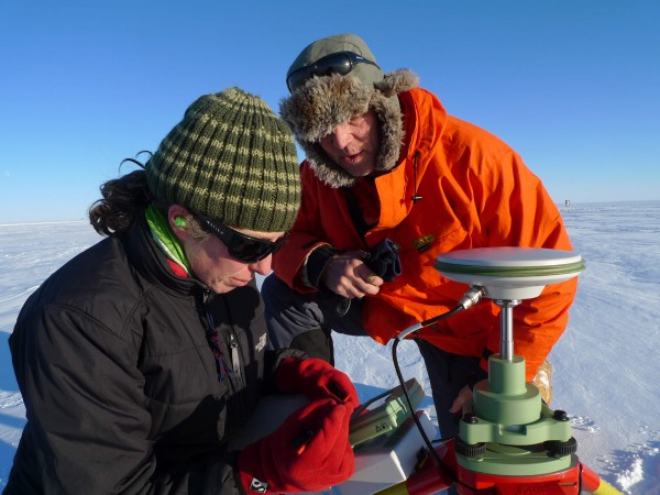 Nick Frearson and Kirsty Tinto of Lamont-Doherty set up the GPS base station in front of Dye 2, Raven Camp, Kangerlussuaq (Image M. Turrin)