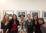 Members of the Women & Sustainability group pause for photo with Professor Ariane van Buren.