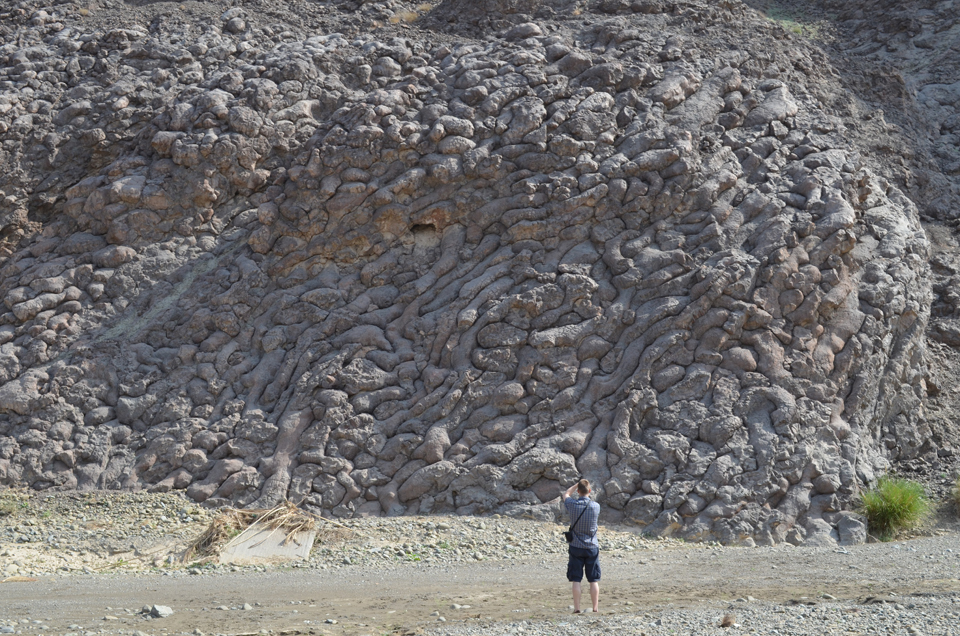 The mountains contain other geological wonders, many of which shed light on normally invisible processes of the seafloor and mantle. Here, Lamont postdoc Kristoffer Szilas confronts an exquisitely preserved outcrop of pillow lavas--toothpaste-like volcanic eruptions that squirted onto the seafloor tens of millions of years ago.