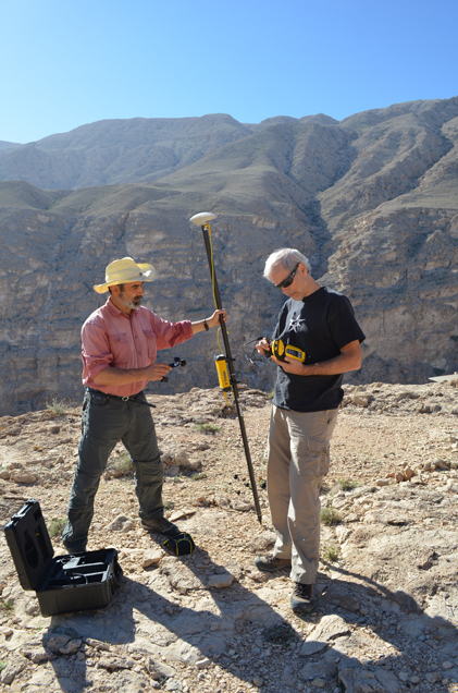 At the wadi's lip, Kelemen and Mullen prepare to descend with a device that will map the canyon walls and floor using the satellite signals of a ground-positioning system.