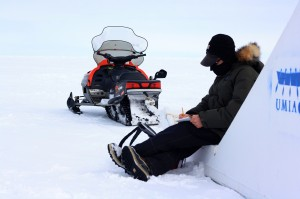 Scientist Andy Juhl makes notes at our first field site about snow depth and distribution.