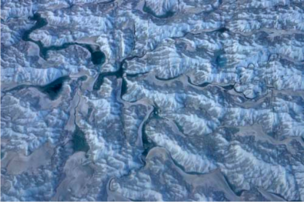 Meltwater Channels on the surface of the Greenland Ice Sheet show how the color can darken absorbing heat energy. (Image P. Spector)