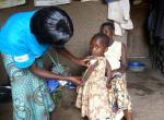 A community health worker and child in Ruhiira, Uganda. Credit: Genevieve Barnard