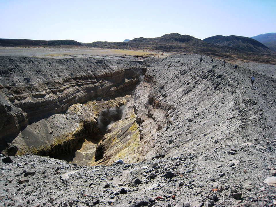 This crevice opened in a matter of hours, during a sequence of very large earthquakes in September 2005. It formed in response to magma being injected into the shallow crust, and is still emitting volcanic gases. This injection of magma was the largest event of its kind to be observed by scientists. (Lorraine Field)