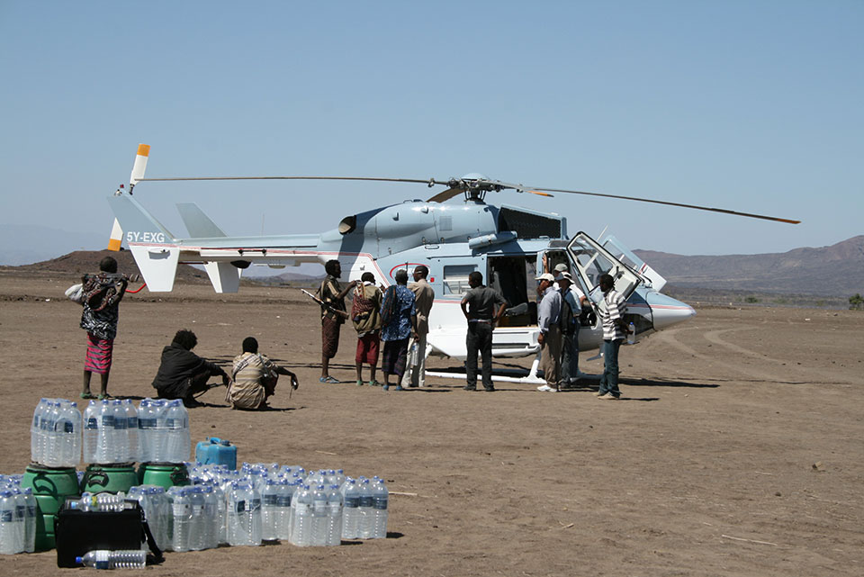 In a region that is vast, largely roadless and dominated by armed tribes, scientists depend on helicopters to get around, and on local people to act as guides and security guards. The climate necessitates large amounts of portable drinking water. (David Ferguson)