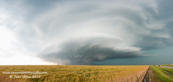 Sculpted Above and Below: The tornado begins to develop under the base, with an inflow tail visible under the incredibly sculpted barrel mesocyclone. Southwest of El Reno, OK.
