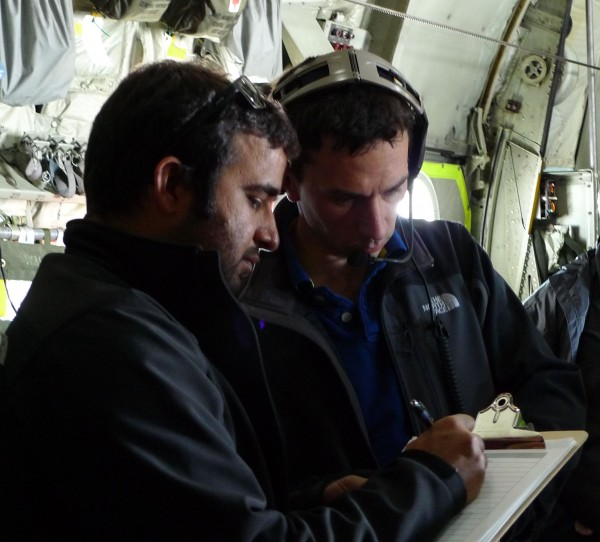 Tej Dhakal and Chris Bertinato confer over the radar data. (photo M. Turrin)