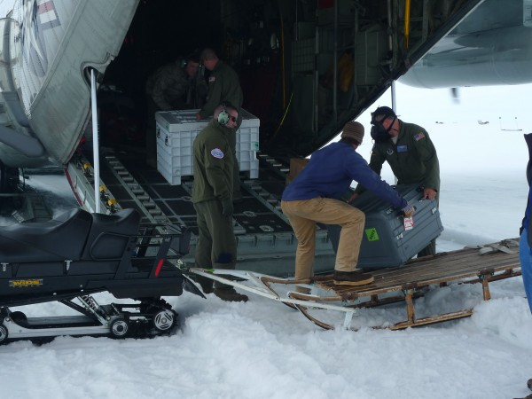 Cargo is loaded into the back of the LC130 at Raven Camp. The aircraft is not turn off during ice landing - all loading is done quickly. (Photo M. Turrin)
