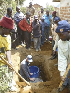 Jim Gaherty installs a seismic station in Masoko as a crowd looks on