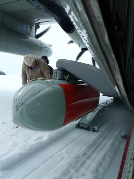 Nick Frearson, lead engineer on the Icepod project prepares to check the pod for snow after the ice runway landing at Raven Camp. (Photo M. Turrin)