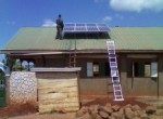 Solar panels being installed in a school in Uganda. Photo: M. Basinger.