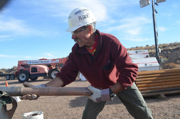 Project co-leader John Geissman of the University of Texas, Dallas, muscles a core out of the pipe. He will carry to a nearby tent for processing.